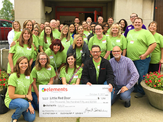 Elements employees volunteer at Little Red Door
