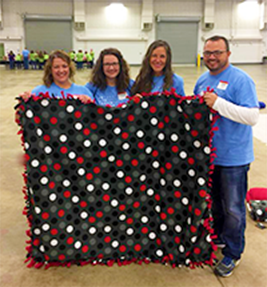 Elements employees make blankets for Indy families in need