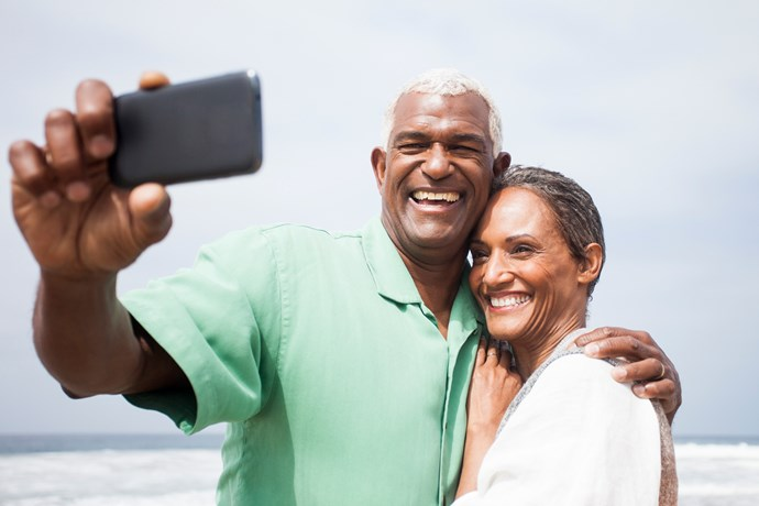 Couple taking selfie on the beach